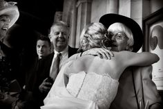 Hugs all round at a St Andrews Wedding -