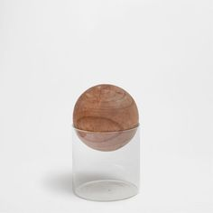 CRYSTAL JAR AND WOODEN BALL