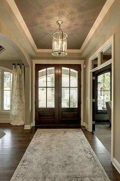 Light gray walls, dark gray ceiling, dark wood floors