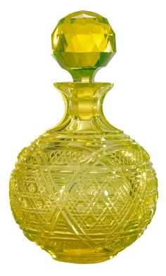 Rare Large Uranium Glass Cologne Bottle. American, last quarter 19th century, expertly cut in Cane pattern, massive matching lapidary stopper, 9 in.