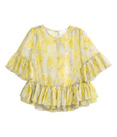 Yellow/floral. CONSCIOUS EXCLUSIVE. Patterned blouse in airy, woven fabric made from a Tencel® lyocell blend. Opening at front of neckline and opening at