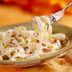 When prosciutto, Italian for air-dried rather than smoked ham, isn't available, cook two extra slices of bacon instead. This rich and creamy pasta dish is as good or better than the popular restaurant version.