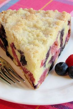 Blueberry-Raspberry Buckle with Sugar Cookie Streusel ~ A buttery, moist and tender cake chock full of fresh blueberries and raspberries bursting with juicy summer berry flavor and a contrasting crunchy sugar cookie streusel sprinkled with extra sugar on top. | breakfast brunch berry cake recipe