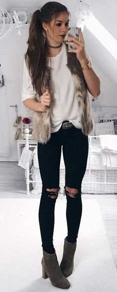 trendy outfit / fur jacket + top + black ripped jeans + boots