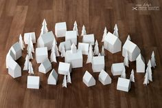 advent calendar. set of construction papers for a little village of 24 houses & 26 trees that can be individually filled with sweets, toys or small gifts.