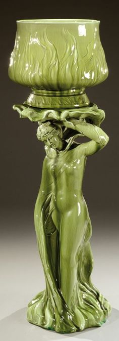 DELPHIN MASSIER Figural Art Nouveau majolica glazed stand and jardiniere, monogram stamp and dated 1901.