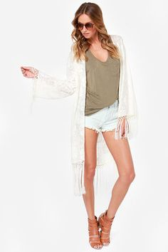 The Mink Pink Summer Cream Lace Kimono has crochet lace covering this extra long kimono top, while of fringe sway from the hem and cuffs of long sleeves. Long Kimono, Kimono Top, White Lace Kimono, Tunic Tank Tops, Crop Tops, Pink Summer, Junior Tops, Junior Outfits, Trendy Tops