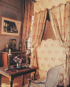 A guest room at Montgeoffroy. The canopied bed and curtains still in the original and slightly faded Braquenié fabric. World of Interiors, June 1985.