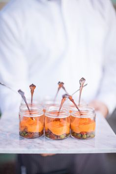 mini shepard's pie bites served on a white carrera marble trays at this modern, La Jolla wedding.  Design by Alchemy Fine Events, Food by Cucina Urbana