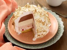 Layer your three favorite ice cream flavors over cake, crown with meringue and broil immediately for a showstopping dessert that's suprisingly easy to make!