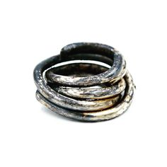 Contemporary Jewelry:  Distressed Sterling silver wrapped ring, set with gold liquid leaf