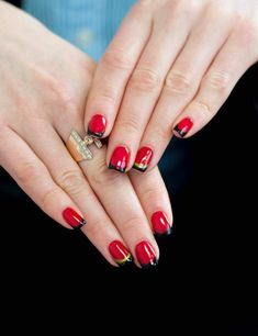 Rouge red nail art with golden and black tapes