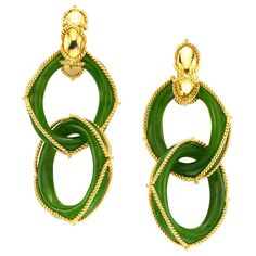 Marchak, A Pair of Gold and Chrysoprase Ear Pendants, designed with two interlocking hoops of chrysoprase, accented by gold wire, signed Marchak, circa 1970s.