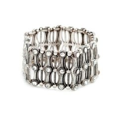 This antiqued silver stretch bracelet features rows of bezel set CZ's, adding sparkle to this bold piece. Amelia is a great statement bracelet. Stretch fit. Available now at https://yolandasgems.kitsylane.com $34.00