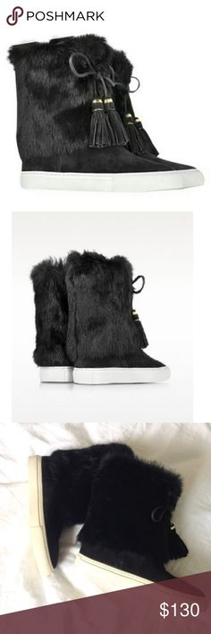 """[BRAND NEW] Tory Burch Angelica Boots Brand new for the fall & winter seasons! Tory Burch leather boot with dyed rabbit fur. Rubber outsoles, cute tassels. Pull-on style. Approx. 1"""" flat sole, 7""""H shaft. Round toe. Tassel-tie front. Faux-shearling (polyester) insole. In perfect condition- Still has size stickers on sole! Box not included. No trades, please! Offers welcome. Tory Burch Shoes Winter & Rain Boots"""