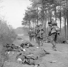 Troops of the King's Own Scottish Borderers advance warily along a lane, past the bodies of German soldiers, east of the Rhine, 25 March 1945 Ww2 Pictures, Ww2 Photos, Military Photos, Military History, British Soldier, British Army, Germany Ww2, Army Infantry, World Photography