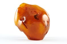 Amber Auctions   Lot 017 Unique rare piece of amber with hollow. The uniqueness is that the hollow is about 2 cm wide and has excellent visibility. Size: 11.5 x 5.6 x 10 cm Weight: 179.4 g.  amberauctions.com Amber Stone, Natural Phenomena, Stones, Stuffed Peppers, Unique, Food, Rocks, Meal, Stuffed Pepper