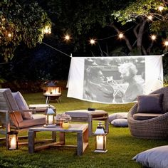 Create a cinema screen with a projector and a sheet