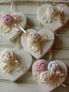 Wood hearts embellished with fabric flowers.