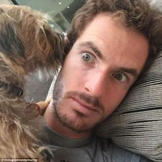 Andy Murray has his ear cleaned by his dog, Maggie, as he chills out while…