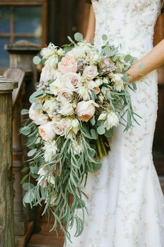 Lush Cascading Bouquet: Pastel Peach English Garden Roses, Pastel Lavender Roses, Blushing Bride Protea, White Mini Orchids, Silver Brunia, Beautiful Greenery + Foliage Including Silver Dollar Eucalyptus>>>>