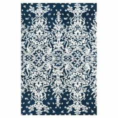 """Perfectly center your living room or den seating arrangement with this eye-catching rug, showcasing a sprawling floral motif in midnight blue.  Product: RugConstruction Material: PolyesterColor: Midnight blueFeatures:  Fade-resistant0.45"""" Pile height Note: Please be aware that actual colors may vary from those shown on your screen. Accent rugs may also not show the entire pattern that the corresponding area rugs have.Cleaning and Care: Vacuum without a beater bar"""