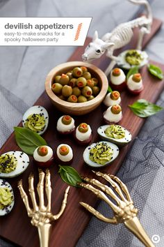 Feast your eyes on these Halloween party snacks. Caprese salad, a party favorite, gets a festive and freaky makeover with pimento-stuffed olives. With a basil leaf as the base, cut a grape tomato in half, pile on a fresh mozzarella ball and top each stack with half of a green olive. Drizzle with olive oil, then watch them disappear. And for a twist on deviled eggs, mix the yolk with guacamole and sprinkle sesame seeds over the top. Everyone will want to get their hands on this delicious…