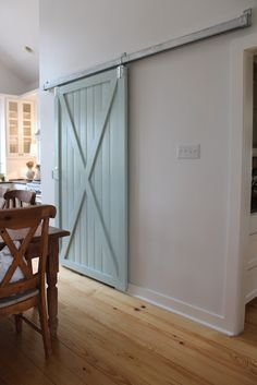 DIY barn door can be your best option when considering cheap materials for setting up a sliding barn door. DIY barn door requires a DIY barn door hardware and a Room, House, Home Projects, Home, Rustic Barn Door, Kitchen Patio Doors, Interior Light Fixtures, New Homes, Great Rooms