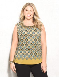 We are giving this top a perfect 10! Perfect for any day of the week, pair with a pencil skirt for work and then with jeans on the weekend.  The best part? The embellished neckline means no need for jewelry -expect maybe a bracelet or two. Imported.