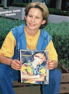 Finally, he held a photo of himself, cause he is so META. | 23 Photos Of Jonathan Taylor Thomas Holding Things