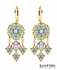 Chandelier Earrings by Lucia Costin Made of 24K Yellow Gold Plated over .925 Sterling Silver with Filigree and Flower Ornaments, Enriched with Lilac, Mint Blue Swarovski Crystals and Lovely Charms; Handmade in USA Lucia Costin. $78.00. Earrings designed by Lucia Costin. Flowers and fancy ornaments beautifully combined. Unique jewelry handmade in USA. Update your everyday style with inspiration when wearing this piece of jewelry. Wonderfully designed with light purple ...