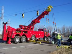 Coil recovery by Waffco Towing @ a semi rollover in Portage IN. 85 ton Jerr-Dan unit handles these coils with ease ! Dump Trucks, Cool Trucks, Big Trucks, Tow Truck Driver, Jeep Truck, Car Hauler Trailer, Towing Company, Towing And Recovery, Heavy Duty Trucks