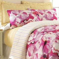 Refresh your master suite or guest room in classic style with this eye-catching reversible comforter set, showcasing a bold floral motif and striped details.   Product: Queen: 1 Comforter, 2 standard shams, 2 standard pillowcases and 1 coverletKing: 1 Comforter, 2 king shams, 2 king pillowcases and 1 coverletConstruction Material: 100% Microfiber polyesterColor:  Pink, white, yellow and cream Features:Floral motifStriped detailsReversiblePillows have button closure  Dimensions:Standard ...