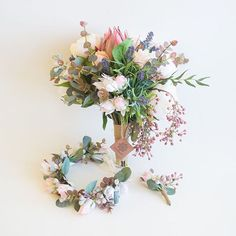So in love with these wedding flowers! Flower crown, buttonhole and bridal bouquet created with life like artificials by our lovely and talented Sascha from the Seaholly team! A beautiful mix of native and garden flowers 😍🌿🌸 #artificialflower #silkflowers #nativeflowers #protea #blushingbride #peony #lavender #pepperberry #gum #eucalyptus #beautiful #pretty #wedding #bridal #bridalbouquet