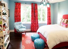 girl's rooms - Madeline Weinrib Atelier Red Mandala Rug Moroccan leather Pouf - Turquoise Blue turquoise blue walls red drapes glossy red chair upholstered Thomas Paul Flock fabric turquoise blue red bed ivory etagere bookcase blue glass bottles chandelier