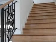 stained stair risers with white molding