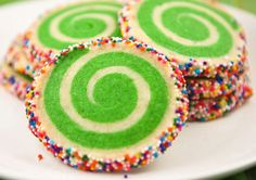 These colorful cookies from Sprinkle Bakes caught my eye last week as I  perused for something festive to bring to Christmas Eve dinner. Aren't they  pretty? The green swirl was fun for Christmas, but any color would be just  as fun. Bright yellow for a spring-time cookie? Orange for a Halloween  cookie? A swirl of colors for a birthday cookie?