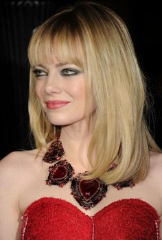 The Best Emma Stone Hairstyles: Blunt Bangs and Shoulder-length Hair