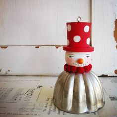 wood and tin snowman ornament.