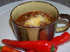 No Bean Low Carb Chili Recipe Main Dishes with water, ground beef, cinnamon, cumin, onions, worcestershire sauce, garlic, salt, chili powder, black pepper, red pepper, allspice, tomato paste, bay leaves, black olives, chili pepper
