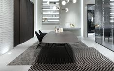 The Manta table by Rimadesio from Pure Interiors.