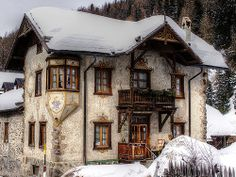 cottage covered in snow