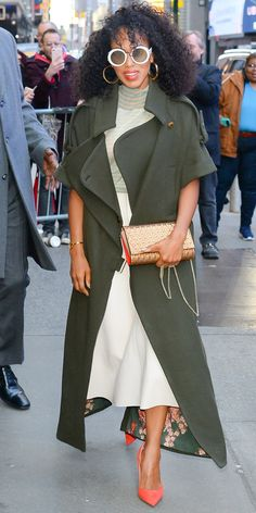 Kerry Washington spruced up a white skirt by adding a mint top, olive jacket, coral heels, and Elie Saab sunglasses.