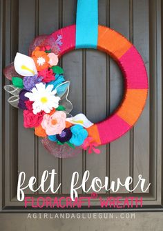 I love felt flowers…they are so pretty…and made with a glue gun! You can pop them in your hair, a vase, on a wreath or on a sign So here are some gorgeous felt flower tutorials! I especially love them because felt is so cheap. They just take a little time and have dynamite results! …
