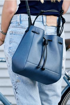 The Mini Bucket from von Holzhausen. A minimal chic Bucket Crossbody in Denim and Black Italian leather. Versatile removable straps allow the bag to be worn as a crossbody, shoulder bag, or handheld.
