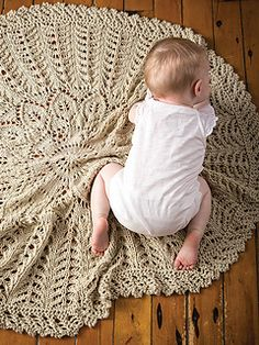 Knit from the center out, Cecelia is a botanical blanket that's perfect for cuddling a baby, wearing as a shawl or simply decorating the home.