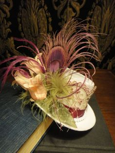 NOT getting married but I LOVE this hat!     ON SPECIAL - Steampunk Garden Wedding White Bridal Mini Top Hat Berry Peacock Green Feathers Pink Flowers Lace Fascinator Bride Wedding. $40.00, via Etsy.