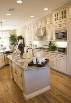 #HomeOwnerBuff luxurious kitchen with white cabinetsa and marble top island