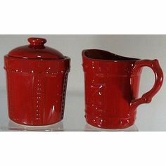 "Signature Housewares 70439 Sorrento Ruby Sugar Dish and Creamer by Signature Housewares. $20.99. Creamer measures 5"" x 4"" and Sugar measures 5"" x 3.5"". Microwave and dishwasher safe.. 70439 Features: -Sugar and creamer set.-Safe for microwave.-Chip resistant for enhanced durability.-Raised leaf and bead design.-Material: Stoneware.-Dishwasher safe. Color/Finish: -Ruby color. Collection: -Complements the Sorrento Ruby collection."