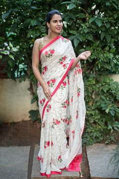 Off white chinon crepe saree with zari and threadwork embroidery + peach border #saree #houseofblouse #embroidery #floral #crepe #offwhite